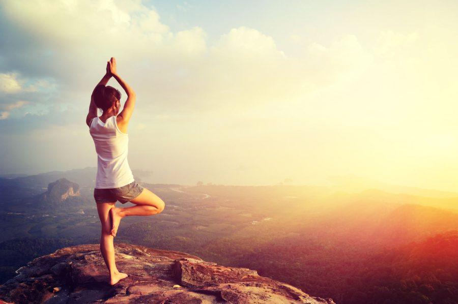 Mountain Yoga Pose on Cliff at Sunrise
